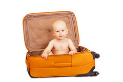 The small child in suitcase for long trips. Stock Images