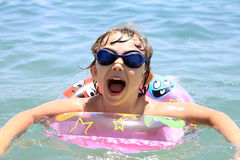 A small child swims in the sea Royalty Free Stock Photos