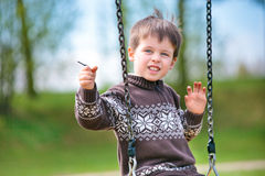 Small child on swing. In playground outdoors stock images