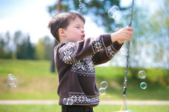 Small child on swing Stock Image