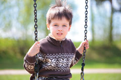 Small child on swing Royalty Free Stock Images