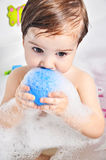 Small child takes a bath. With foam Stock Image