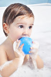Small child takes a bath Stock Image