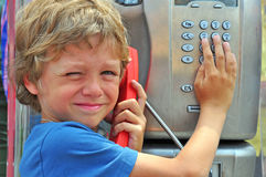 Small child talking by phone Royalty Free Stock Photography