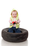 A small child with a toy in the lid Royalty Free Stock Photos