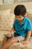 Small child using a digital tablet Stock Photo