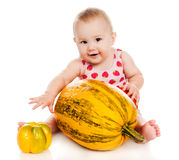 Small child with vegetables and fruits Stock Photography