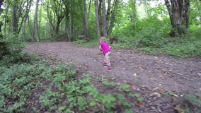 Small child walking in the forest. Trips to nature. Community children with nature. Fresh and healthy air in the. Mom walks her daughters in the woods. Family stock footage