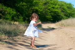 Small child in the white dress Stock Photo