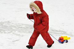 Small child in winter clothes with typewriter Stock Image