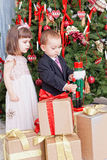 Small children and boxes with gifts Stock Images