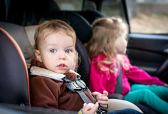 Small children in the car Royalty Free Stock Photography