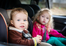 Small children in car seats in the car Royalty Free Stock Images