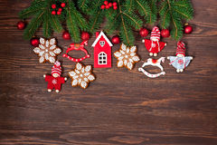 Small children christmas   figures on wooden background Stock Images
