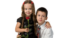 Small children with flowers. a boy and a girl. Stock Photos