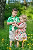 Small children in the garden Royalty Free Stock Images