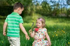 Small children in the garden Stock Photography