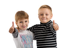 Small children. girl and boy making a thumbs up. Royalty Free Stock Photos