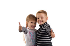 Small children. girl and boy making a thumbs up. Royalty Free Stock Image
