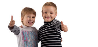 Small children. girl and boy making a thumbs up. Royalty Free Stock Photography