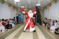 Small children look like Santa Claus dancing on holiday in kindergarten - Russia, Moscow, December 17, 2016. Small children look like Santa Claus dancing on a Royalty Free Stock Photography