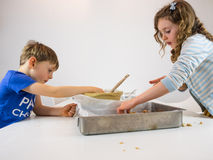 Small children making cookies Royalty Free Stock Photo
