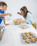Small children making cookies Royalty Free Stock Images