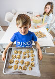 Small children making cookies Royalty Free Stock Photography