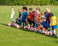 Small children in many different coloured football Stock Image