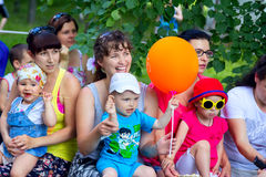 Small children with mothers watching performance Stock Photos