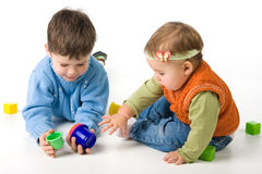 Small children play with blocks Royalty Free Stock Image