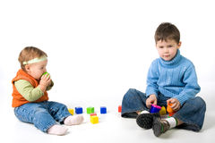 Small children play with blocks Royalty Free Stock Images