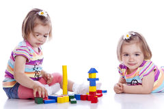 Small children play with toys. On white background Stock Photography