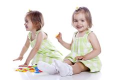 Small children play with toys Royalty Free Stock Image