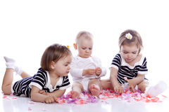 Small children play with toys. On white background Royalty Free Stock Photography