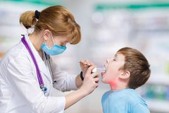 Small children playing a doctor and a pediatrician touching a toy bear with a stethoscope royalty free stock image