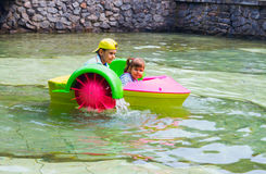 Small children ride alone on boat. stock photography