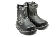 Small children`s boots. On a white background Royalty Free Stock Photo