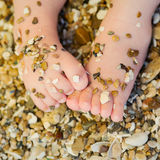 Small children's feet in the sand. Children's feet in the sand Stock Photos