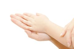 Small children's handles in female hands Royalty Free Stock Image