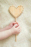Small children's hands hold the wooden tablet. Small children's  hands hold the wooden tablet Royalty Free Stock Photo