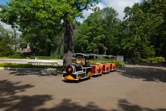 small children`s train waiting for its little passengers in the park stock photography