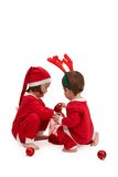 Small children in santa costume playing Stock Photos