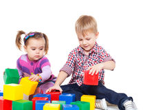 Small children sit on a floor Stock Photography