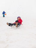 Small children sledging Stock Photos