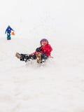 Small children sledging Stock Photos