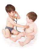 Small children and a stethoscope Royalty Free Stock Photo