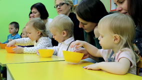 Small children and their mothers engaged in the development of intelligence stock video