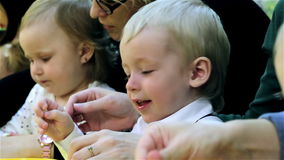 Small children and their mothers engaged in the development of intelligence stock video footage