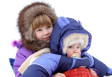 Small children are very glad to a snow Stock Photography